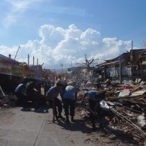Police officers clearing the roads in Cateel, Davao Oriental.